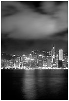 Hong-Kong Island across the harbor by night. Hong-Kong, China (black and white)
