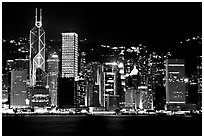 Hong-Kong skycrapers by harbor at night. Hong-Kong, China (black and white)