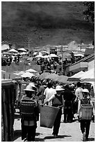 Periphery of  Monday market frequented by hill tribespeople. Shaping, Yunnan, China ( black and white)