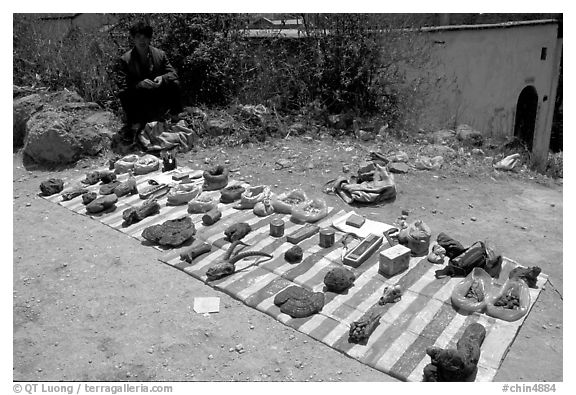 Selling strange items. Shaping, Yunnan, China (black and white)