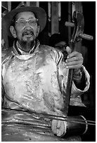 Elderly musician playing the traditional two-stringed Ehru. Baisha, Yunnan, China (black and white)