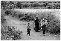 Women returning from the fields. Baisha, Yunnan, China ( black and white)