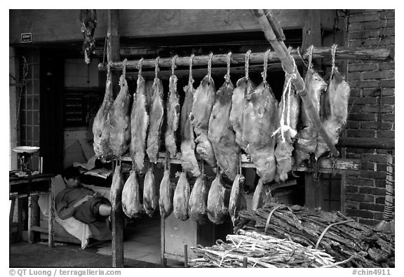 Ham made with cattle legs, salted when raw, and dried under the sun. Kunming, Yunnan, China (black and white)