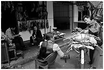 Loading roasted meat on a bicycle. Kunming, Yunnan, China ( black and white)