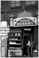 Store owned by a woman of the Muslim community. Kunming, Yunnan, China (black and white)