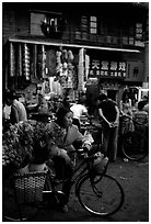 Flower peddler in an old alley. Kunming, Yunnan, China (black and white)