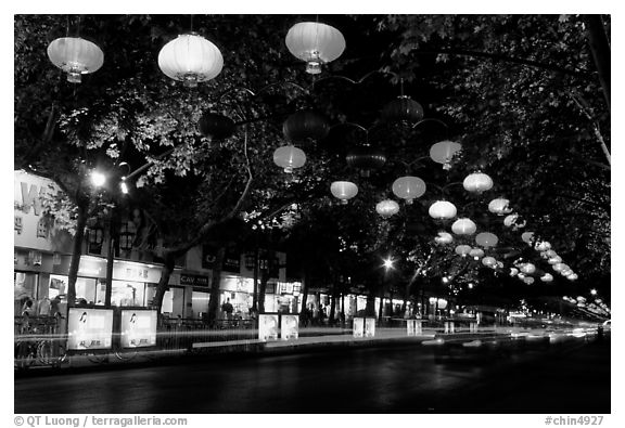 Zhengyi Lu illuminated by lanterns at night. Kunming, Yunnan, China (black and white)