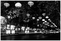 Zhengyi Lu illuminated by lanterns at night. Kunming, Yunnan, China ( black and white)