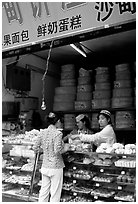 Women at Muslim pastry store. Kunming, Yunnan, China (black and white)
