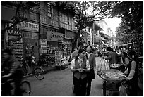 Street vendors in an old street. Kunming, Yunnan, China (black and white)
