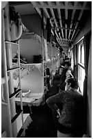 Inside a hard sleeper car train. (black and white)