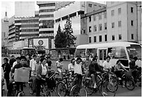Bicyclists waiting for traffic light. Kunming, Yunnan, China (black and white)