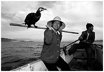 Aboard a cormorant fishing boat. Dali, Yunnan, China (black and white)