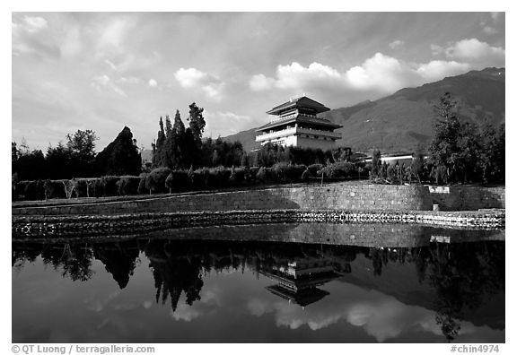 Chong-sheng Si, temple behind the Three Pagodas, reflected in a pond. Dali, Yunnan, China (black and white)