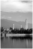 San Ta Si (Three pagodas) reflected in a lake, early morning. Dali, Yunnan, China (black and white)
