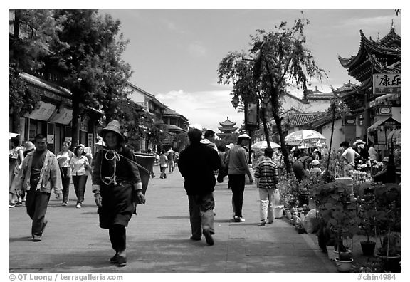 On one of the recently enlarged pedestrian streets. Dali, Yunnan, China (black and white)