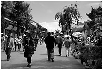On one of the recently enlarged pedestrian streets. Dali, Yunnan, China ( black and white)