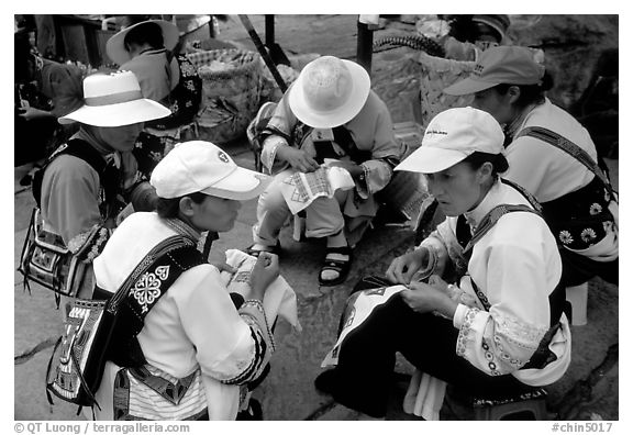 Sani women making embroidery. Shilin, Yunnan, China (black and white)
