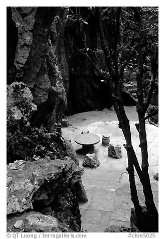 Quiet courtyard between limestone pillars. Shilin, Yunnan, China (black and white)
