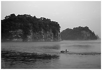Cliffs of Lingyun Hill and Wuyou Hill at dusk, whose shape evokes a lying buddha. Leshan, Sichuan, China ( black and white)