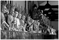 Some of the 1000 individually unique Terracotta arhat monks in Luohan Hall. Leshan, Sichuan, China ( black and white)