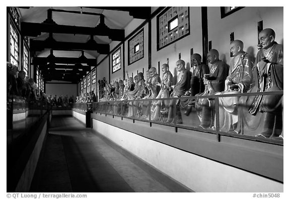 Some of the 1000 Terracotta arhat monks in Luohan Hall. Leshan, Sichuan, China (black and white)