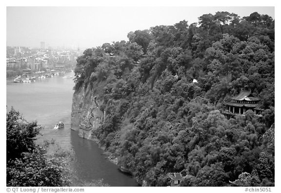 Cliffs of Lingyun Hill with the city in the background. Leshan, Sichuan, China (black and white)