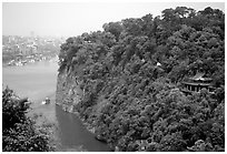 Cliffs of Lingyun Hill with the city in the background. Leshan, Sichuan, China ( black and white)