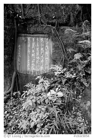 Chinese inscription in stone in the gardens of Dafo Si. Leshan, Sichuan, China (black and white)