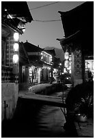 Streets, bridge, wooden houses, red lanterns and canal. Lijiang, Yunnan, China ( black and white)