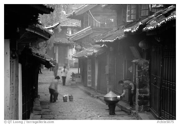 Street in the morning with dumplings being cooked. Lijiang, Yunnan, China (black and white)