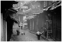 Street in the morning with dumplings being cooked. Lijiang, Yunnan, China ( black and white)
