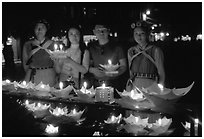 Candlelight lanters to be floated on a canal at night. Lijiang, Yunnan, China (black and white)