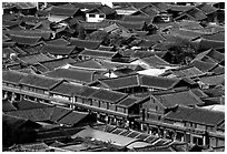 Rooftops of the old town seen from Wangu tower. Lijiang, Yunnan, China (black and white)