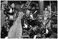 Elderly musicians of the Naxi Orchestra playing traditional instruments. Lijiang, Yunnan, China (black and white)