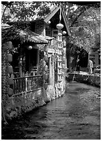 Houses along a canal. Lijiang, Yunnan, China (black and white)