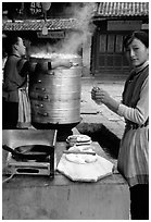 Naxi Woman preparing the baba flatbreat. Lijiang, Yunnan, China (black and white)