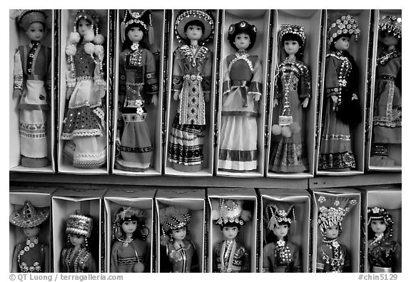 Dolls wearing traditional Bai dress. Lijiang, Yunnan, China (black and white)