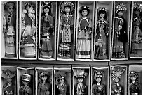 Dolls wearing traditional Bai dress. Lijiang, Yunnan, China ( black and white)