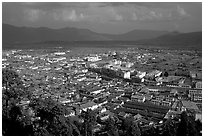 Old town, new town, and surrounding fields seen from Wangu tower. Lijiang, Yunnan, China (black and white)
