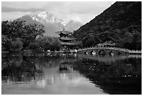 Pavillon and Jade Dragon Snow Mountains reflected in the Black Dragon Pool. Lijiang, Yunnan, China ( black and white)