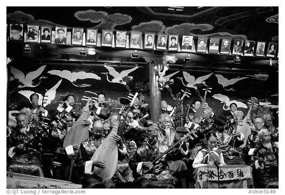 Naxi orchestra in Dayan Naxi concert hall. Lijiang, Yunnan, China (black and white)