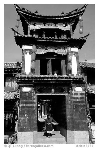 Woman under the Kegong tower archway. Lijiang, Yunnan, China (black and white)