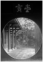 Circular doorway in Bailongdong temple. Emei Shan, Sichuan, China (black and white)