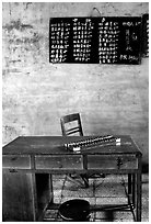 Desk counting frame and Chinese script on blackboard. Emei Shan, Sichuan, China (black and white)