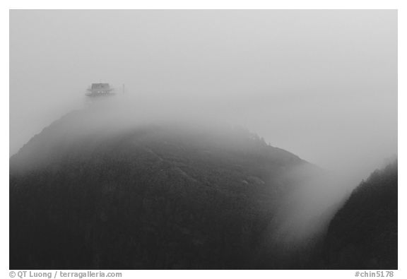 Fog sweaps over Wanfo Ding (Ten Thousand Buddhas Summit) at dusk. Emei Shan, Sichuan, China (black and white)