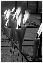 Candles burning. Emei Shan, Sichuan, China (black and white)