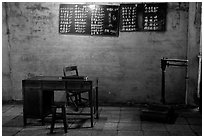 Desk with counting frame, blackboard with Chinese script, scale. Emei Shan, Sichuan, China (black and white)