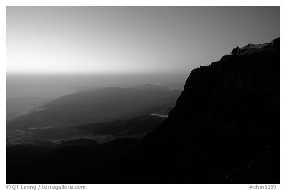 Sunset on Jinding Si (Golden Summit), perched on a steep cliff. Emei Shan, Sichuan, China (black and white)