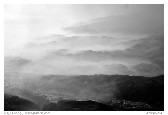 Receding ridges in fog, seen from Jinding Si, morning. Emei Shan, Sichuan, China (black and white)
